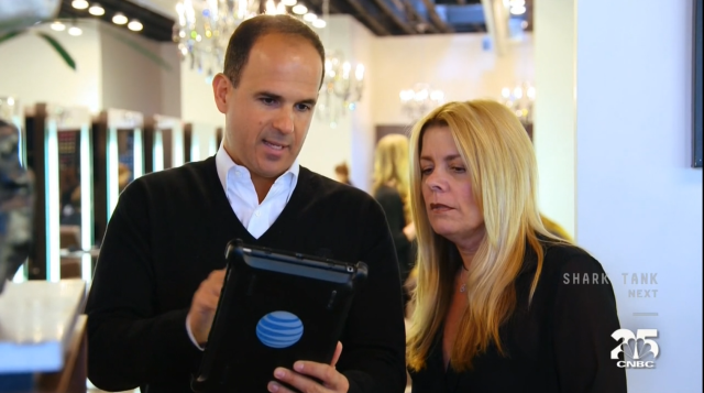 Marcus shows Carolyn some of the new whizzbang tech she'll be using to run the salons.